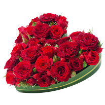 heart shaped arrangement of red roses
